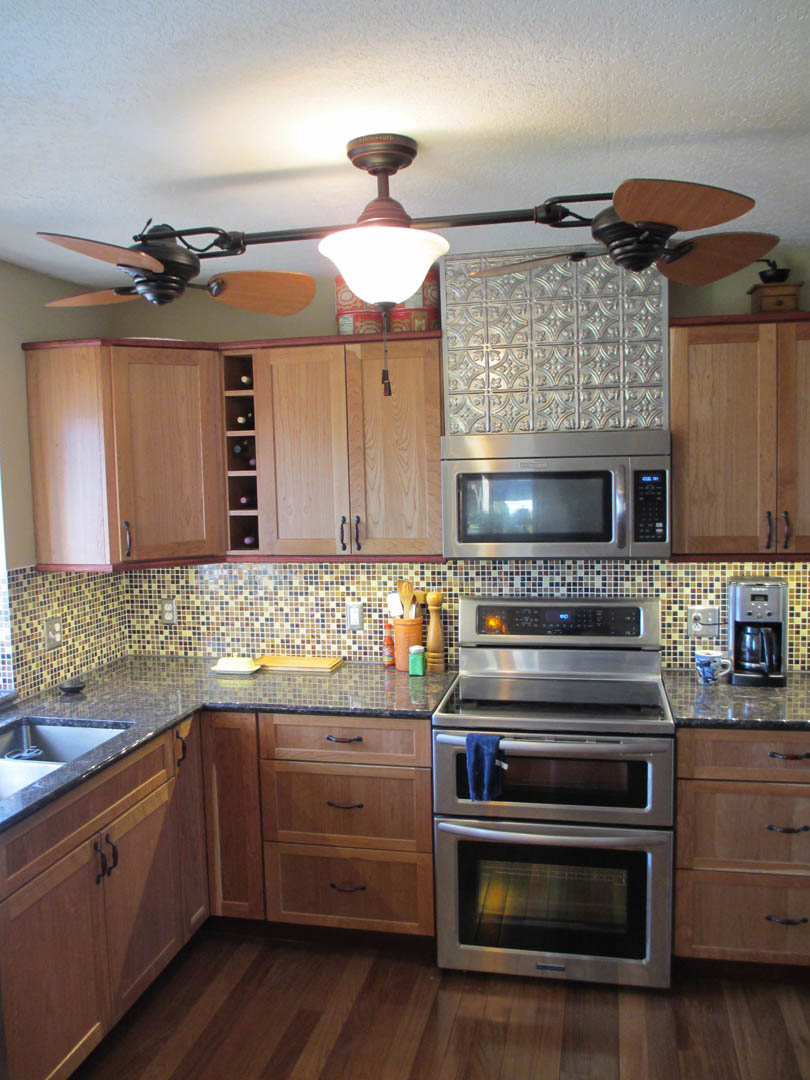 A Kitchen Remodel Seven Tile Backsplash And Faux Textured Tin
